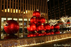 Giant Christmas Ornaments (TravelsJ19) Tags: giantchristmasornaments christmas red ornaments newyork joycecortilesso winter exxonbuilding 1251 giant holiday radio city music hall