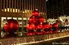 Giant Christmas Ornaments (Purple Fox Photography LLC) Tags: purplefoxphotographyllc giantchristmasornaments christmas red ornaments newyork joycecortilesso winter exxonbuilding 1251 giant holiday radio city music hall