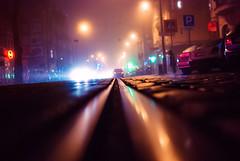 on track (ewitsoe) Tags: rails rail track poznan jezyce poland ewitsoe nikon d80 35mm street city life living middle road low streetlevel neon night evening mist blur cars traffic polska europe