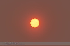 The Sun in Smokey Skies (Amazing Sky Photography) Tags: sun haze smoke atmosphere binoculars forestfire sunspot absorption nakedeye