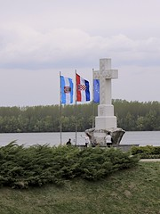 White Cross at the Confluence of the Vuka and Danube Rivers (oxfordblues84) Tags: sky woman water clouds river europe cross croatia flags tourists danube cloudysky danuberiver walkingtour vukovar memorialcross euflag vikingrivercruise 5photosaday vikingemblashoreexcursion