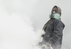 breathing sulphur (Thomas Sobottka) Tags: mist yellow canon indonesia volcano java mask outdoor smoke poor gas east crater caldera sulphur breathe 70200 miner indonesien vents suffocate visibility fumes schwefel bergarbeiter ijen gase minenarbeiter