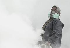 breathing sulphur (Thomas Sobottka) Tags: mist yellow canon indonesia volcano java mask outdoor smoke poor gas east crater caldera sulphur breathe 70200 miner indonesien vents suffocate visibility fumes schwefel bergarbeiter ijen gase minenarbeiter