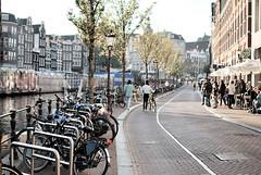 Amsterdam tra bici e canali (M_Verdina) Tags: road urban amsterdam architecture 35mm person strada persone architettura citt bicicletta canali urbanshot mercatogalleggiante