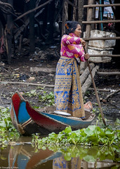 Beauty in the Midst of Squalor (allentimothy1947) Tags: cambodia foreign travel tonle sap lake floating village skirt boat squalor beauty woman