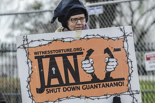 Anti-Torture Activist Josie Setzler Holds a Sign Marking the January 11th Anniversary of Guantánamo's Opening