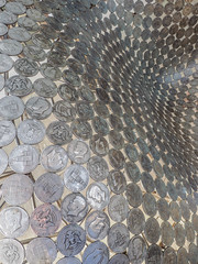 The Half Dollar sculpture (Seascape snapper) Tags: chatsworth coins halfdollars metal pattern