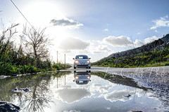 On the road (Irìni) Tags: road cinquecento fiat500 500 reflection pozzanghera after rain cloud clouds nuvole irenecolletti nikond3100 nikon