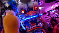Swami greeting a Dragon in a Bangkok bar on Chinese New Year. (ashabot) Tags: swami dragon bangkok thailand bangkokstreetscene red nigh nightshots nightlife noflashnightshots yellow travel chineselunarnewyear 2017