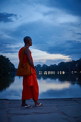 Monk on a bridge, Angkor, Cambodia (Alex_Saurel) Tags: asia type portray orientation temple night walking photoreport moine river religieux fullbody religion buddhist day reportage ancient clothes travel portrait portraiture adult people sunset bouddhisme photospecs planitalien position imagetype vertical fullframe kesa cambodge planpied monk photojournalism archicategory nature scans stockcategories pleinformat buddhism time photoreportage style walk sony50mmf14sal50f14