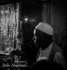 Tunisian medina seller (johnnewstead1) Tags: travel cruise blackandwhite holiday blackwhite mediterranean tunisia tunis olympus fantasia medina msc johnnewstead mzuiko