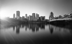Pittsburgh Pinhole (The Stugots) Tags: camera city bridge bw sun white black film home monochrome analog buildings river lens dead stand is wooden still long exposure shoot pin pittsburgh fuji hole image kodak no tripod hc110 pinhole semi iso flare fujifilm 6x9 neopan 100 rise developed zero rapid development ilford bnw zeroimage acros zero69 fixer filmisnotdead issf mefoto
