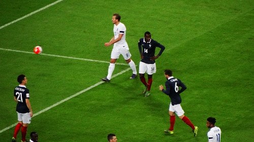 The France defence - Laurent Koscielny, Blaise Matuidi and Yohan Cabaye - prepare for England's corner, with Harry Kane close by