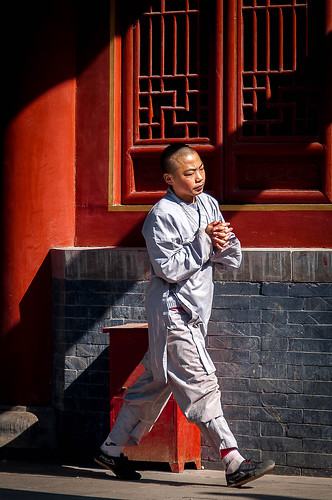 Budhist monk hurrying to attend service