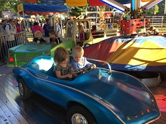 """Paul and Inde Ride in a Car at Sonny Acres • <a style=""""font-size:0.8em;"""" href=""""http://www.flickr.com/photos/109120354@N07/23198541746/"""" target=""""_blank"""">View on Flickr</a>"""