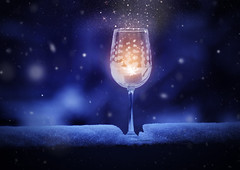 Winter Romance (miss.interpretations) Tags: magic snow snowfall winternight winterevening evening darknessgoblet wine cider champagne celebration love affection candle tealight rail patio deck wineglass stars fairydust glow blue bluebackground gold softsnow snowflakes glitter glitteringsnow warmth winter january colorado 2017 missinterpretations art