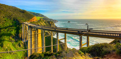 Bixby Bridge Sunset (KC Mike D.) Tags: bridge arch coast coastline bixbybridge bigsur sur big road highway one highway1 pch pacificcoasthighway destination route cliffs rugged sea pacific ocean pacificocean water waves sunset westcoast cables telephone line grass green hills canyons monolith