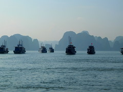 Tourist Boats @ Halong Bay (stardex) Tags: boat sea seascape landscape halongbay hill mountain sky vietnam