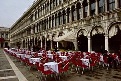 Early for Lunch (armct) Tags: facade arch mullions arcade cloister contrast roundarchedwindows architecture red tablecloth white waiters piazza piazzasanmarco procuratievecchie offices colonnade tables