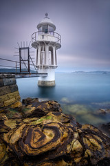 Circles (Rodney Campbell) Tags: longexposure sunrise cremornepoint gnd09 cpl water littlestopper lighthouse rocks clouds newsouthwales australia au