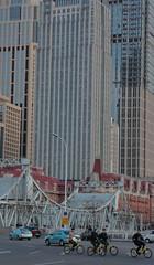 Tianjin - cycling at Jiefang Bridge (Bruce in Beijing) Tags: jiefangqiao liberationbridge engineering internationalbridge pivotaldrawbridge haiheriver concessionareas wanguobridge zhongzhengbridge girders transport navigation cycles modern highrise commercialdevelopment contrasts