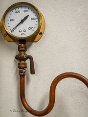 Steam pressure gauge (Victor Wong (sfe-co2)) Tags: old hot texture clock industry scale water metal wall danger work vintage rust energy iron industrial technology antique si pipes pipe engineering dial device steam gas equipment machinery international needle valve heat copper temperature value standards pressure brass measure gauge kpa valves heating boiler measuring unit measurement indicator manufacturing kilo wallmounted pascals