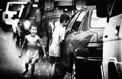 Children beg for spare change, Manila, Philippines