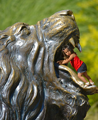A Place to Play (swong95765) Tags: cute girl statue parents kid play bokeh expression lion climbing curiosity
