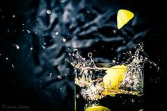 A Dash of Lemon (Jason S Kenny) Tags: food water blackbackground lemon beverage depthoffield lime splash highspeed offcameraflash