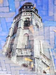 Trapped in a puddle (Wouter de Bruijn) Tags: reflection tower water rain puddle churchtower clocktower fujifilm middelburg langejan xt1 fujinonxf35mmf14r