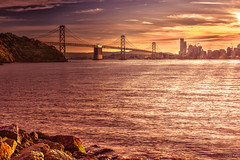 The Golden State (Žèę Ķ) Tags: baybridge sanfrancisco california bridge water sea sky sun winter architecture sunset travel clouds light ocean landscape seascape goldenhour sunflare stones outdoor oakland