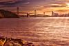 The Golden State (Žèę Ķ) Tags: baybridge sanfrancisco california bridge water sea sky sun winter architecture sunset travel clouds light ocean landscape seascape goldenhour sunflare stones outdoor oakland