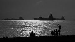 Family Fun (elenaleong) Tags: marinabarrage seaside silhouettes family elenaleong backlights