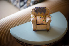 Pinned! (Fret Spider) Tags: pattern geometry symmetry crescent stripes pins afghan cushion pillow lazyboy bokeh bokehdelicious dof depthoffield outoffocus vintage classic manuallens sonya7ii canonfd85mmf12sscaspherical pastel color