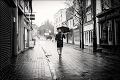 Dreek (h_cowell) Tags: rain rainy rainyday umbrella weather dreek street streetphotography chestergate macclesfield cheshire reflection wet candid light blackandwhite nikefex panasonic gx7 appicoftheweek mood atmospheric walking tunnel