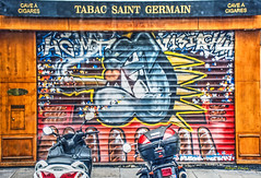 closed (albyn.davis) Tags: paris france street streetart colors colorful bright vivid vibrant motorcycles shop storefront europe
