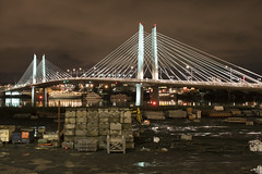 Tilikum Crossing (Curtis Gregory Perry) Tags: portland oregon tilikum crossing bridge night longexposure willamette river construction project building span reflection boat ship nikon d810 bridgeofthepeople cablestayed max mass transit 2015 south waterfront suspension light rail 50mm f12 cloudy cloud sky miguelrosales