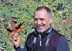 Michael Chuck loves a good autumn leaf. (sea turtle) Tags: autumn orange canada fall smile face leaves yellow vancouver leaf britishcolumbia handsome robson englishbay stanleypark westend robsonstreet denman denmanstreet englishbaybeach michaelchuck