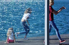 Barcelona, 2015 (A-cat-and-a-half) Tags: barcelona street travel blue autumn girls sea urban sun reflection water colors composition reflections travels nikon candid streetphotography jeans beautifulgirl portvell mediterranian redbluewhite