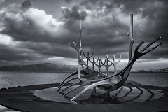 The Sun Voyager (Chipyluna) Tags: statue sculpture metal aluminium sun sunvoyager clouds sky sea mountains iceland reykjavik holiday trip outdoors blackandwhite bw mono monotone monochrome black white silver grey island vacation nikon nikond3200 d3200 nature landscape seascape water beach coast tide shore light reflection bright beautiful weather cold