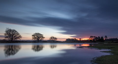 Mogshade at sunrise (iscook72) Tags: newforest mogshade pond hampshire national park sun sunrise cloud sky nd1000 long exposure blur movement water reflection light tree colour dawn outdoor landscape