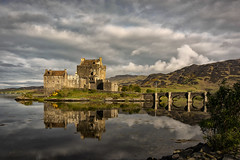 A postcard from Eilean Donan (cliveg004) Tags: eileandonan westhighlands scotland castle sea reflections mountains gorse clouds countryside rural outdoor nikon d5200 challengegamewinner