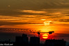Sunrise on a new busy day (Gian Floridia) Tags: milano alba busy camp cantieri city construction crane gru landscape orange red silhouette sole sorgere sun sunrise urban workplace yellow