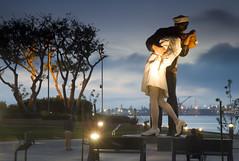 A kiss at twilight (San Diego Shooter) Tags: kiss statue sandiego sandiegobay sandiegokissstatue downtownsandiego sunset sandiegosunset romantic romanticstatue military longexposure marina sandiegomarina