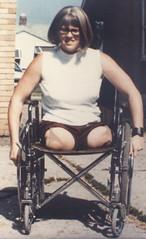 102-06 (jackcast2015) Tags: amputee legamputee wheelchairwoman wheelchair disabledwoman crippledwoman amputeewoman nolegs doubleabovekneeamputee dakamputee girlswithglasses glasses girlswearingglasses
