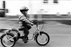 Noel riding a bike (tobiasnykanen) Tags: cyklar ilford ilfordhp51600 jobo joboatl1500 minoltamcrokkor5017 minoltax500 noel pakon pakonf135 pakonf135plus xtolstock blackandwhite bw boy barn child children speed panorering pano