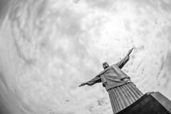 On Top of the World, Looking Up at Christ the Redeemer. (Geraint Rowland Photography) Tags: brazil sky blackandwhite rio clouds religious heaven catholic christ god religion jesus christtheredeemer christianity catholicism jesuschrist ontopoftheworld godsquad sevenwondersoftheworld wideanglephotography armsopen christtheredeemerbrazil braziliantourism visitrio travelphotographygeraintrowlandinbrazil blackandwhitechrist