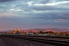 Metals Factory at Sunset (Chase Ryan Shelby) Tags: california sunset mountains clouds factory desert traintracks highdesert hesperia goldenhour mojavedesert
