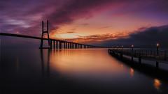 Bridge sunrise (sgsierra) Tags: bridge portugal sunrise river de puente gold agua lisboa amanecer vasco oro gama