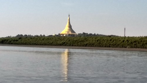 Global Peace Pagoda with its golden dome. Its reflection in the Gorai creek adds to the grandeur.